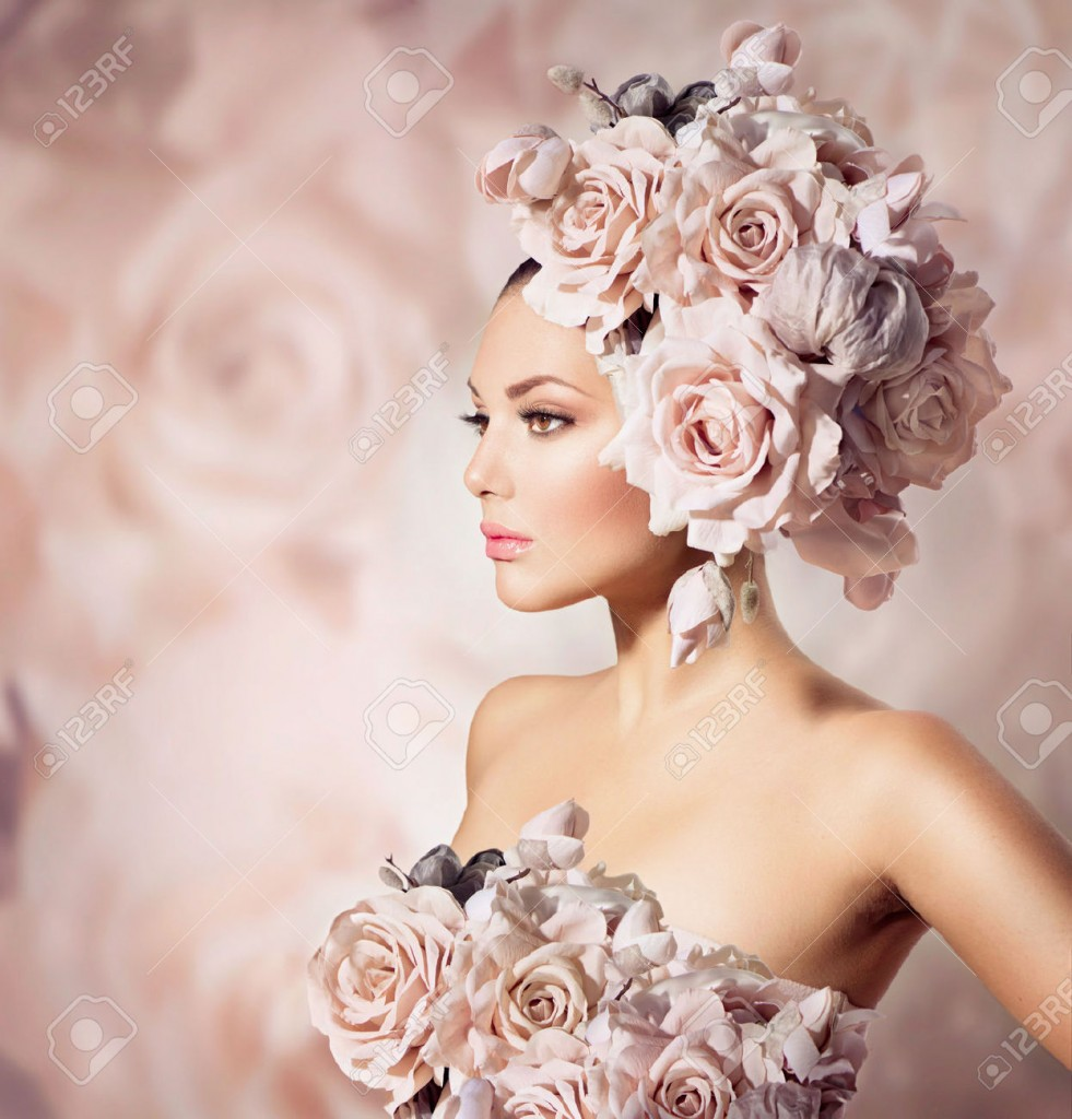 Beautiful women, with roses on her head and roses on her dress and its the subtle pink rose colour background