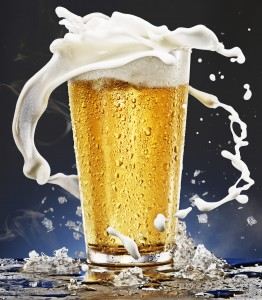 Juicy looking pint of beer with the foam splashing out. How a man's beer habit can change through you