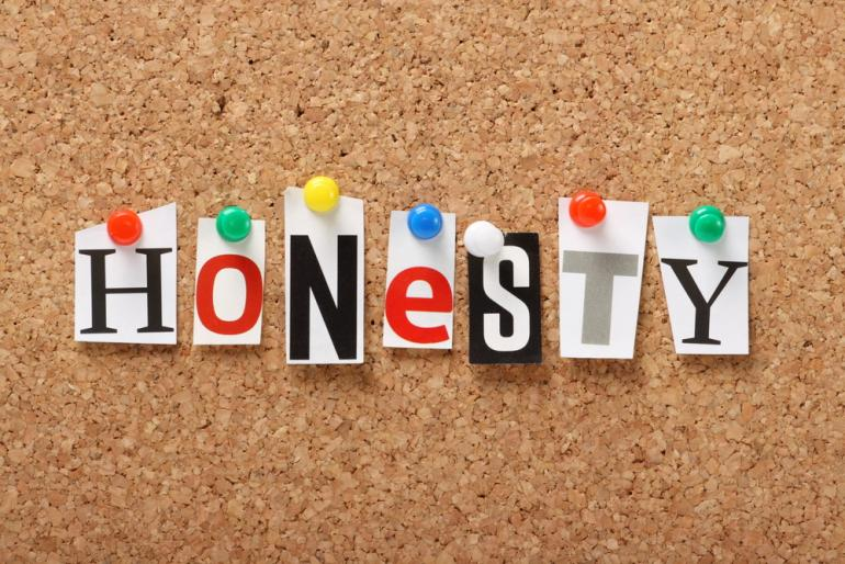 "each letter of ""honesty"" pinned to a board with coloured pin"